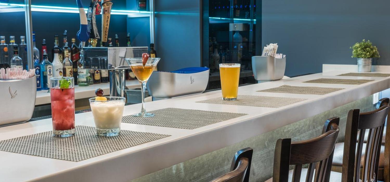Enjoy libations at the Trellis Lounge on site